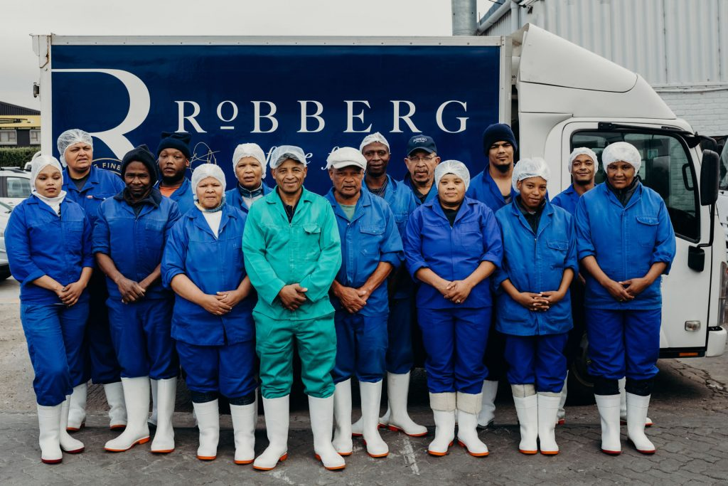 Fresh Fish Processing Team from left to right: Madelein Kamfer, Elaine Fredericks, Max Sinxo, Jason Phukela, Andrina Roman, Elizabeth Hartley, Victor Wewers, Pirvin Langdown, Alfred Mbuzwa, Leon Paulse, Megan Boesak, Virgill Africa, Francisca Wewers, Realstone Pedro, Cathleen Mabie