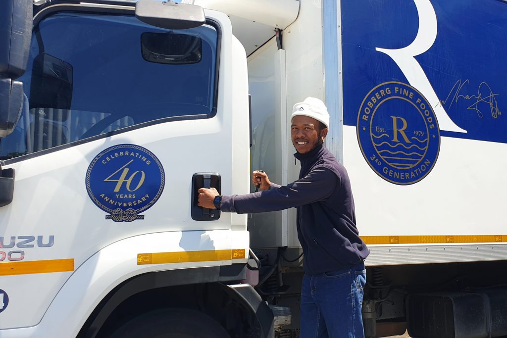 Riaan (Spyker) is a Driver's Assistant on a delivery truck for Robberg Fine Foods, a truly family company in Plettenberg Bay.