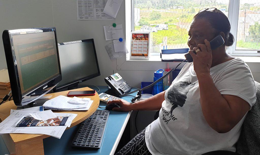 Sharon Petersen at her desk
