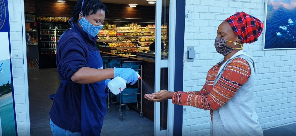 sanitising-before-entering-robberg-store-during-covid-19-lockdown
